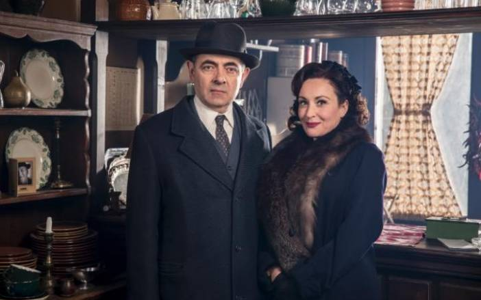 Rowan Atkinson as Maigret and Lucy Cohu as his wife.