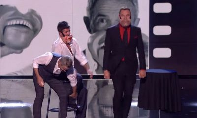 Unhappy: Simon Cowell was pulled up on stage as part of one act this evening